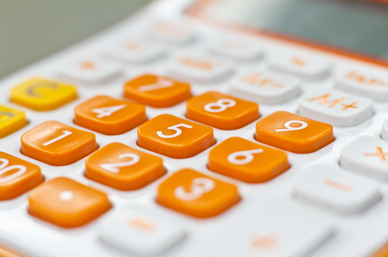 Calculator with bright orange buttons