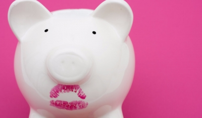 Piggy bank with lipstick on it