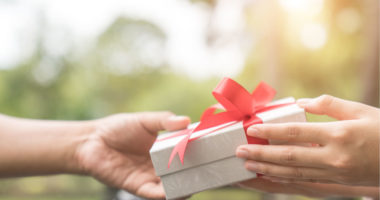 hands exchanging a gift