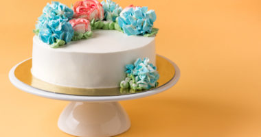 Cake on cake stand with yellow background