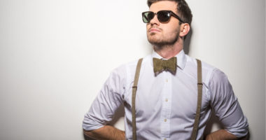 hipster guy on white wall