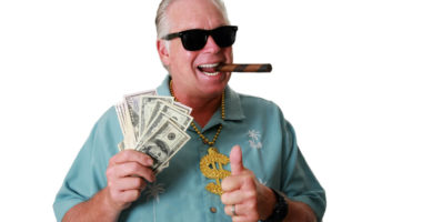 Man with cigar holding cash
