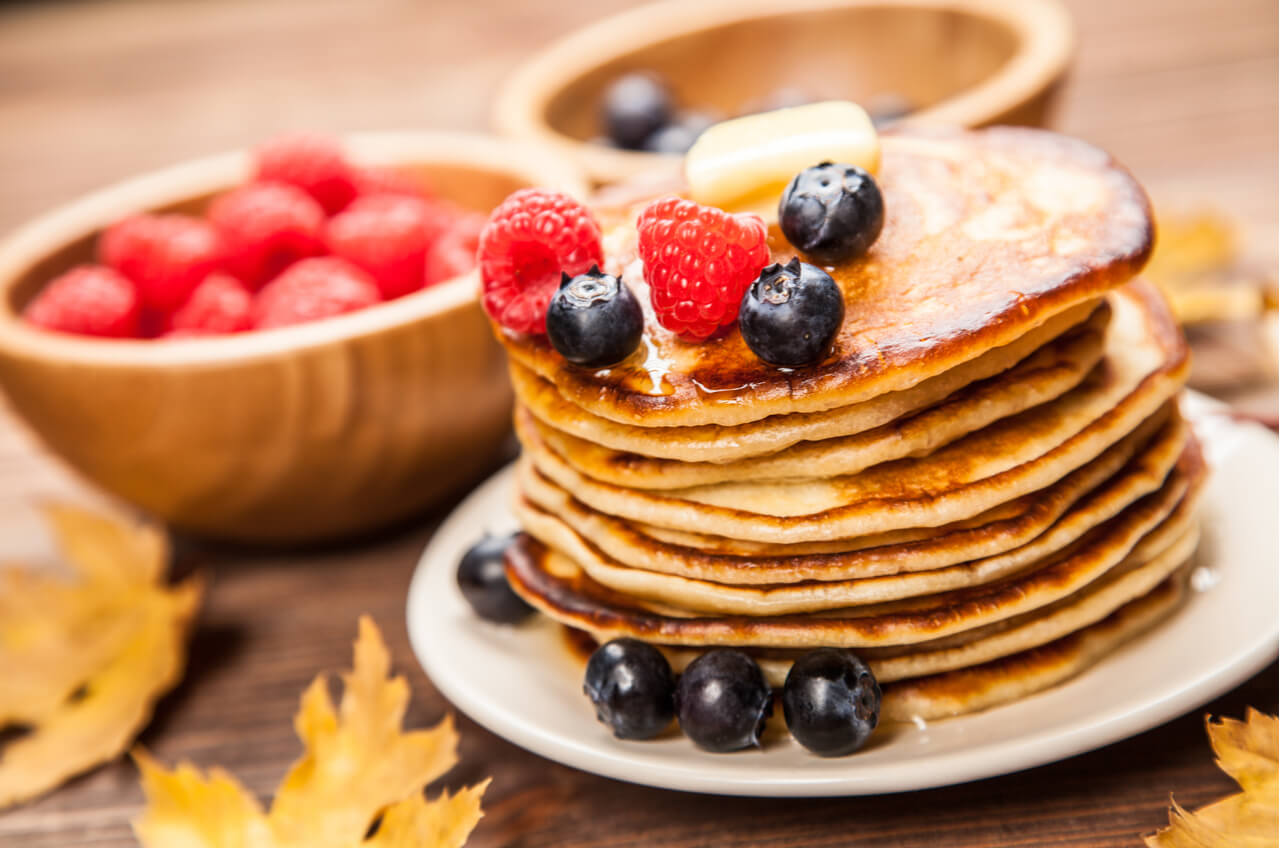 big stack of pancakes with fruit
