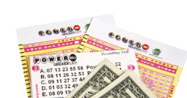 Powerball ticket and money