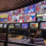 DraftKings teams with Sports & Social to open sports bars.